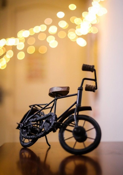Miniature cycle on a table with a cool bokeh background