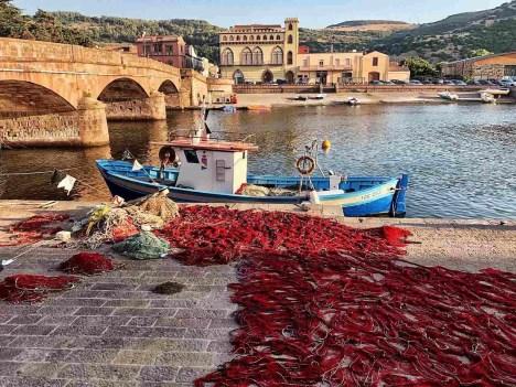 Bosa bridge and a fishermen boat - Sardinia road trip itinerary