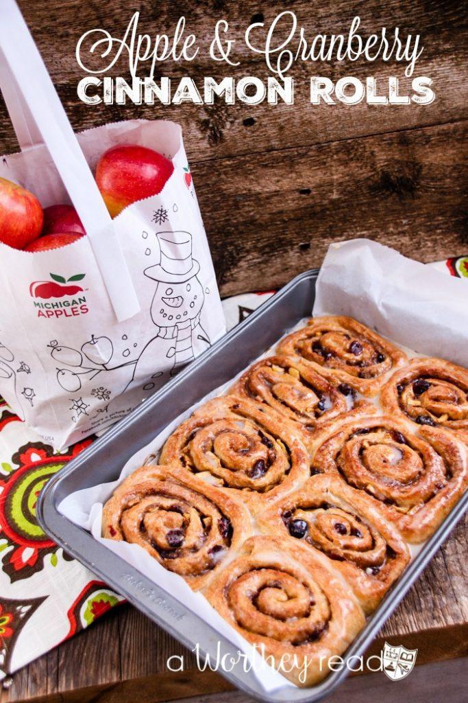 Apple & Cranberry Cinnamon Rolls- Perfect for a crisp Falll morning, easy breakfast idea or dessert. Easy Cinnamon Roll Recipe that everyone will love.