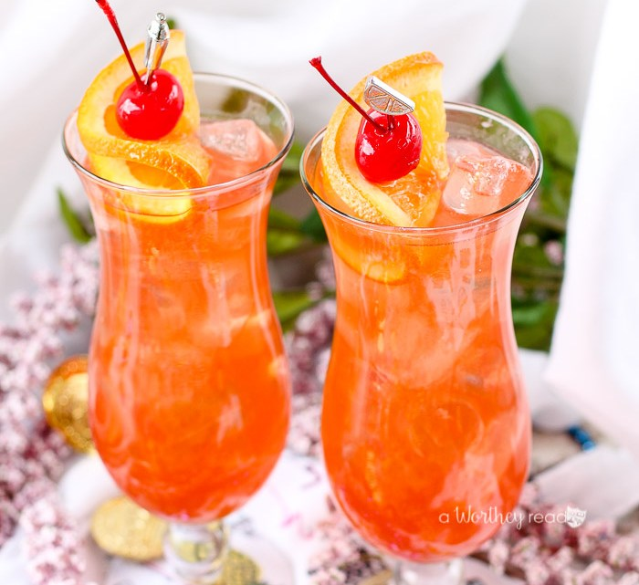 Celebrate Mardi Gras with this Classic Hurricane Cocktail. Mixed with rum, coconut rum, passion fruit juice and simple syrup.