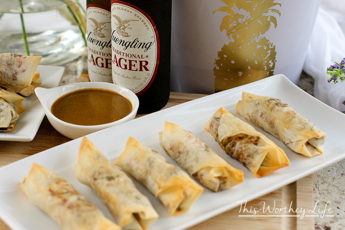 Summer is here, and a good bratwurst recipe is calling my name. But not just any brat will do. I created a bratwurst recipe using the Smithfield®'s Yuengling® Lager Beer Brats, along with a few other ingredients to make Bratwurst Spring Rolls, plus a spicy mustard dipping sauce. Thanks to Smithfield for sponsoring this post. All creatives listed below, recipe, and opinions are 100% my own. Yuengling Bratwurst Spring Rolls + Spicy Mustard Dipping Sauce