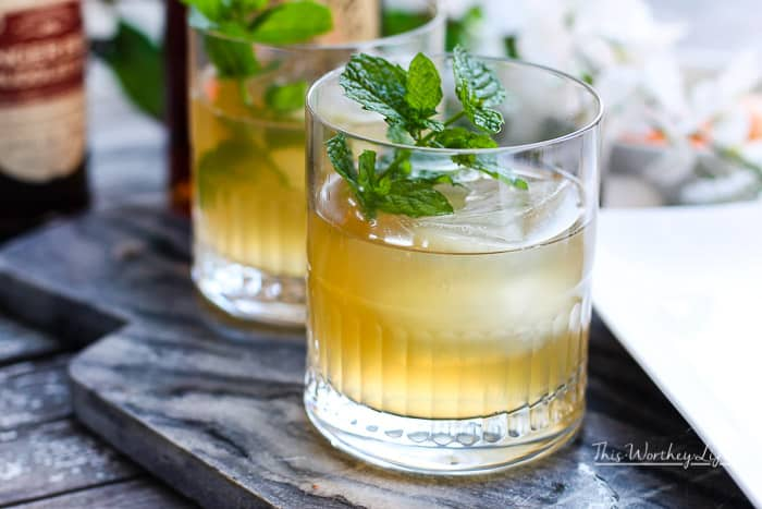 Get ready for all things fall and football season by taking a classic mule, mixing bourbon, ginger beer, and black ink bitters to make an American Mule Bourbon Cocktail.