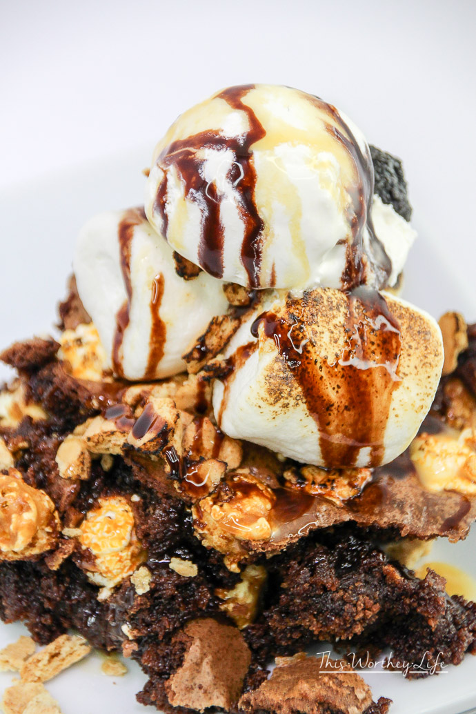 Get creative with homemade brownies and popcorn. See how we created this easy brownie dessert idea, the Popcorn S'mores Brownie Dessert! It's filled with chocolatey goodness, popcorn, caramel, and of course, ice-cream!