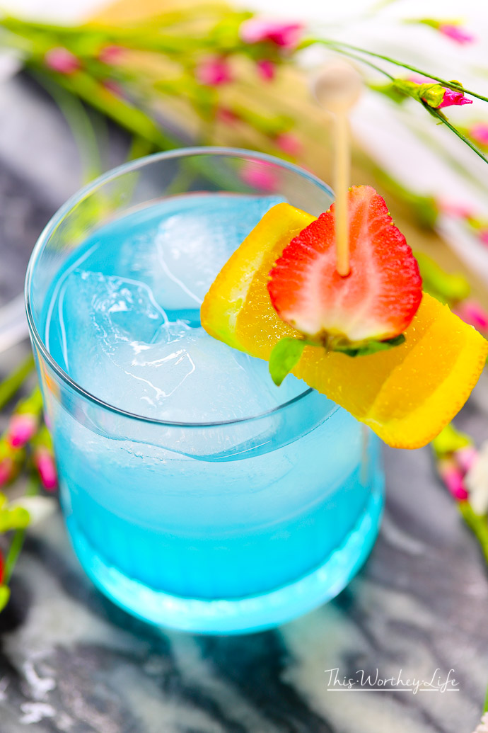Toast to Marvel's Black Panther movie with our Vibranium cocktail made withhpnotiq liqueur. This hpnotiq drink is a beautiful, pastel blue drink- perfect to serve at any party. Cheers to Marvel's Black Panther movie, featuring a black superhero!