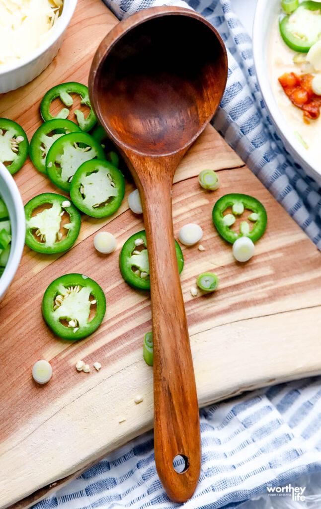 fresh peppers on a wood cutting board