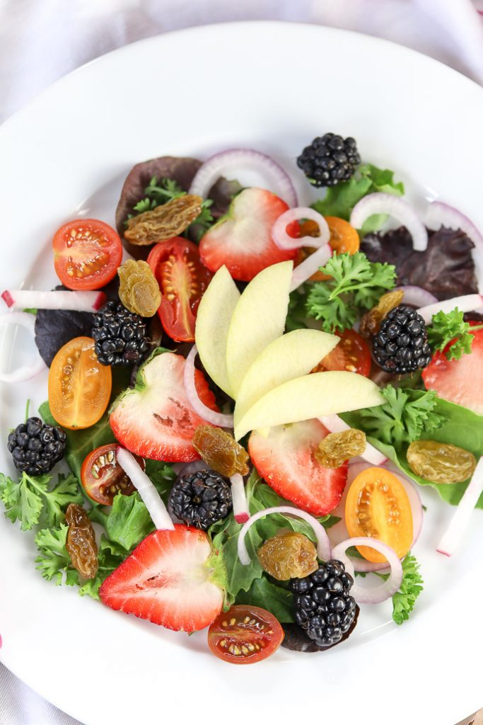 With loads of fresh and local fruit all around us, it's the perfect time to make a summer salad. Try our Berry + Apple Summer salad, loaded with strawberries, berries, tomatoes, mixed salad greens and more. grab the recipe down below.