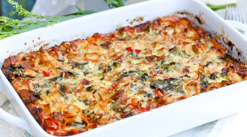 Take breakfast to a new level with our loaded bacon + peppers breakfast strata! Oozing with a variety of cheeses, fresh peppers, thick-cut bacon, collard greens, onions and more, this loaded strata says, breakfast is served!