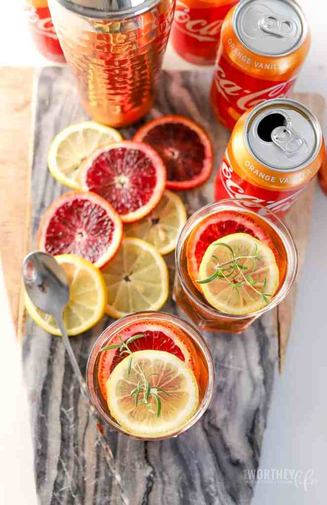 With the new Coca-Cola® Orange Vanilla available now, I've created a Citrus Rye Honey Cocktail with this new flavor. Made with honey, rye, orange bitters, and orange curacao, this will be a cocktail you will want to add to your summer playlist of drinks.