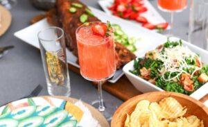 summer menu- baby back ribs, cape cod chips, drink, salad, dip