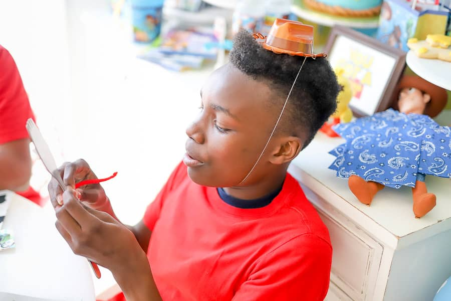 black boy at a toy story party