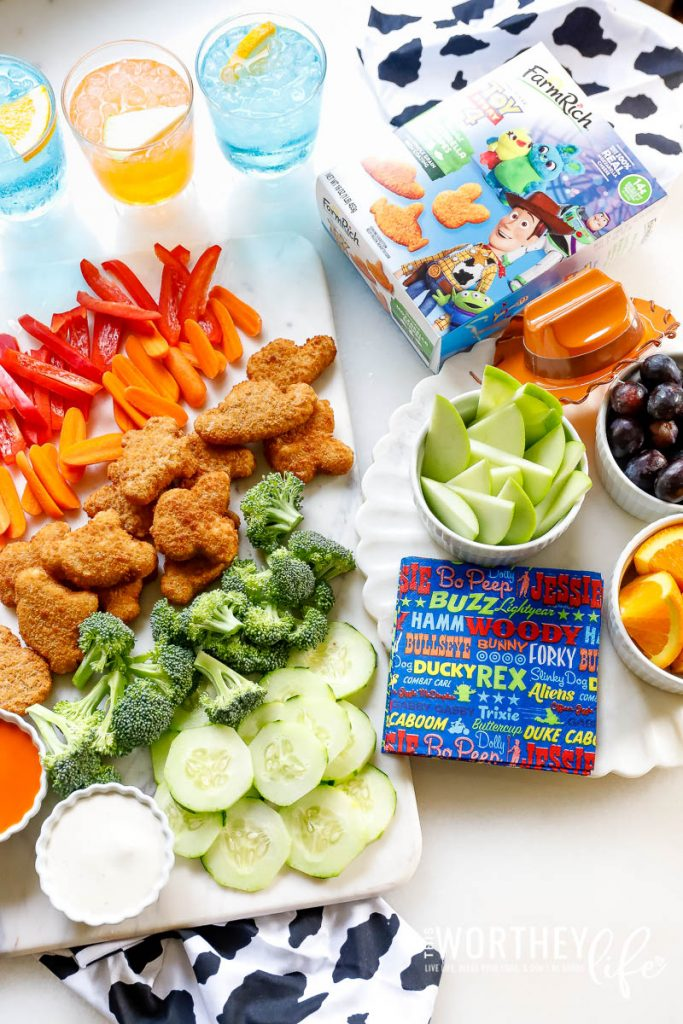 Create a kid-approved snack board featuring Toy Story 4 Mozzarella Shapes from Farm Rich snacks and appetizers. These snacks are perfect for an after-school snack, Toy Story themed party food, or great for the kids' lunchboxes.