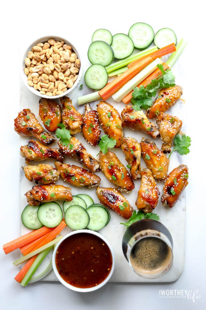 Thai Chicken Wings on a white platter with white surface