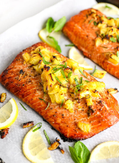 honey pineapple salmon on parchment paper