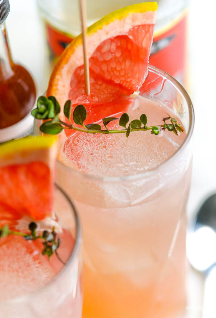 grapefruit drink in a tall frosted glass