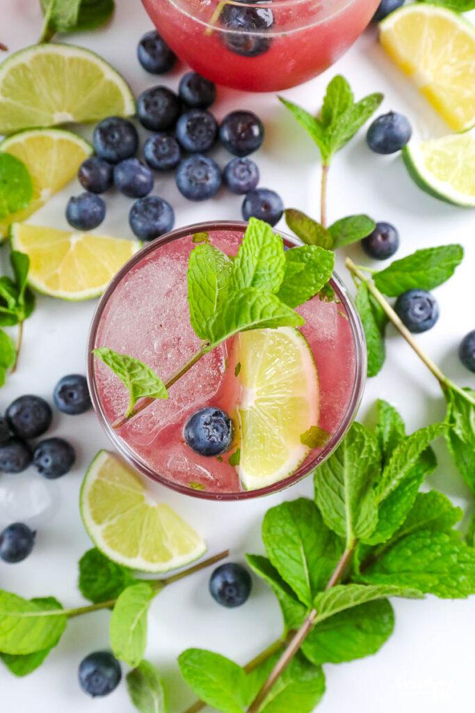 fresh fruit around a blueberry drink