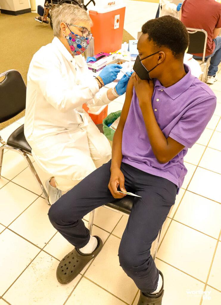 black child getting the covid vaccine