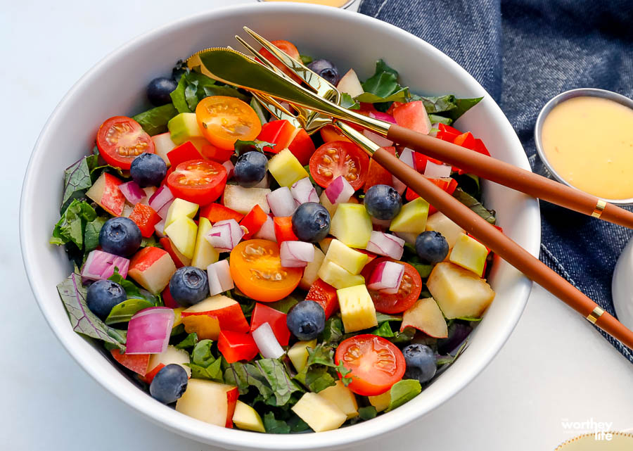 a bright colorful summer chopped garden salad in a white salad bowl