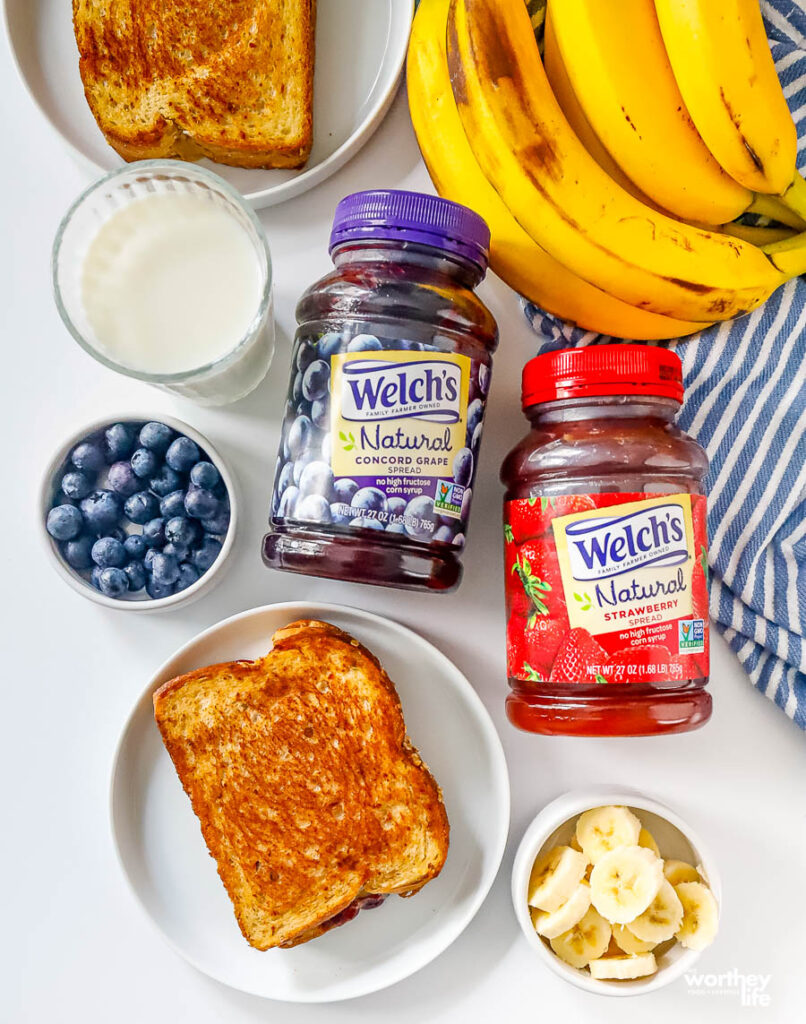 preparing a peanut butter and jelly plus fruit grilled sandwich