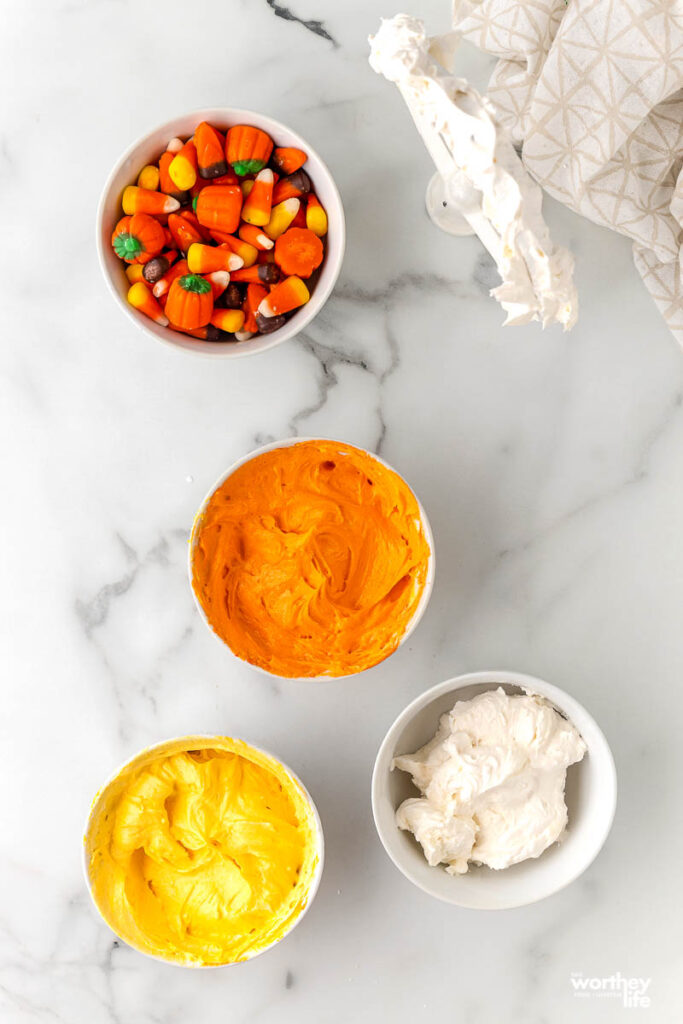 bowls of frosting for candy corn dessert