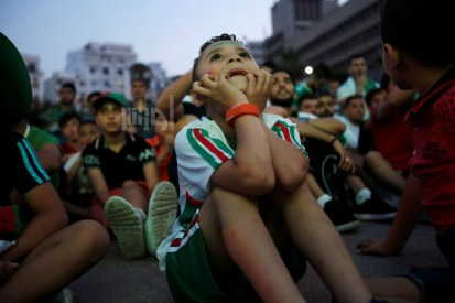 Boys react after Algeria missed a goal during a match against Tanzania at the Africa Cup of Nations 2019 (Afcon), in Algiers