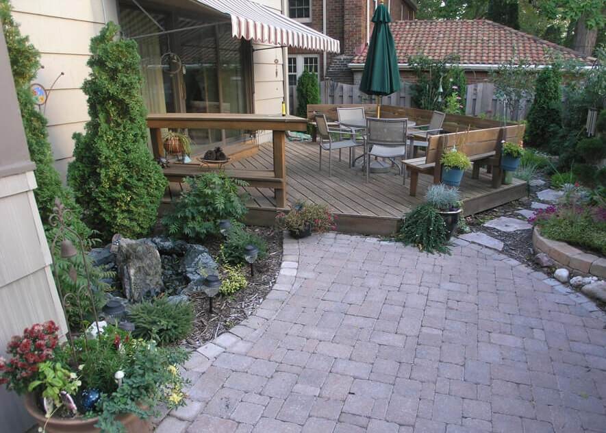 Deck Vs Patio Steps Down From House To Patio Axel Landscape | Patio With Stairs From House | Residential | Curved Paver | Main Entrance Stamped Concrete Front | Walkout Basement | Decorative