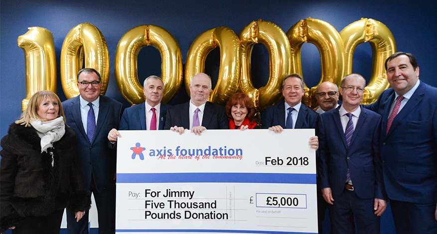 Axis patrons hold one million pound cheque.