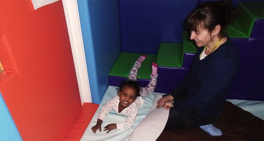 A child plays in the sensory soft room at Tower Hamlets Opportunity Group.
