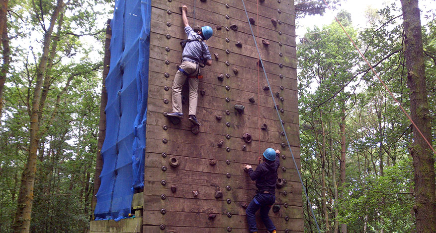 Two children rock climbing at school trip with Quest Specialist School