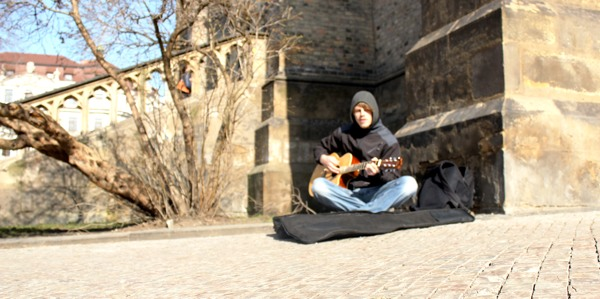 A musician with a quitar playing Zluty pes on the Namesti Miru square