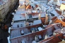 Prague_redroofs_inwinter_insnow_from_LesserTownBridgeTower