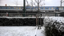 Prague-blue-train-railway-bridge-in-snow