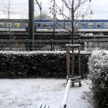 Prague-blue-train-railway-bridge-in-snow