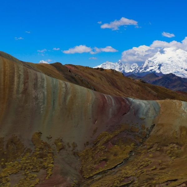 The striated colours of Rainbow Mountain with Ausangate in the background