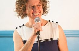 Female smiling with microphone
