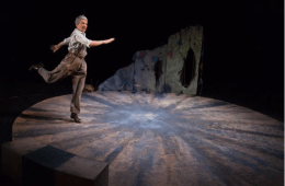 Woman skips across a stage