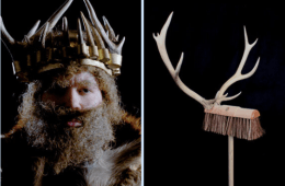 Man with thick beard wearing a horned crown and a broom with antlers