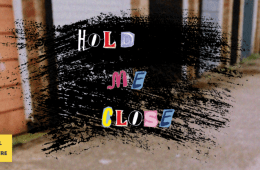 The words 'hold me close' are central in brightly coloured fonts, on a black background superimposed onto a street. Bottom left spells out 'canal cafe theatre'