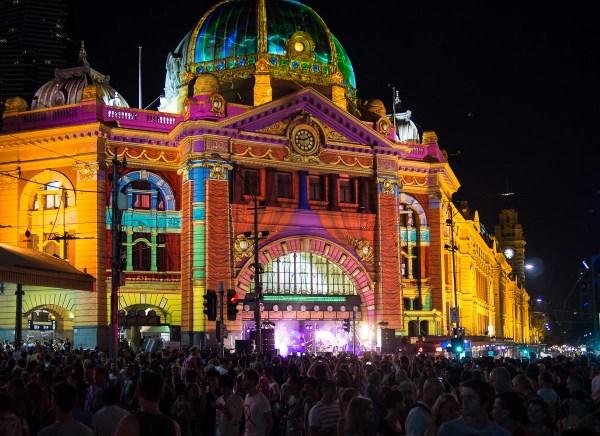 the band plays under Flinders St railway station clocks