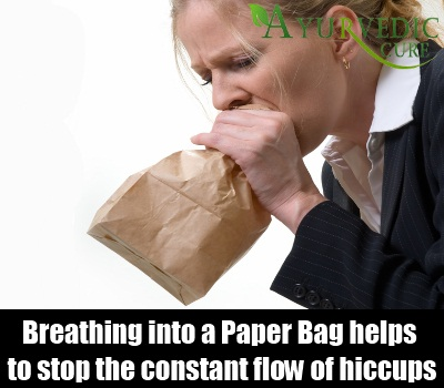 breath into paper bag