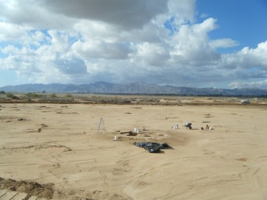 Overview of an excavated portion of the Luke Solar project area, with the White Tank Mountains in the background