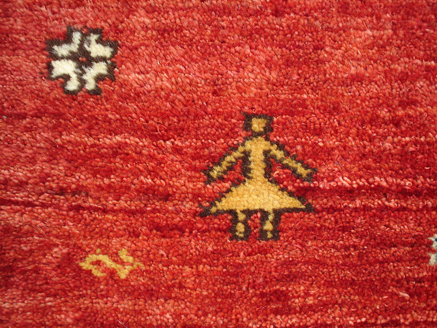 Qashqai Gabbeh rug in a blue field with madder and yellow