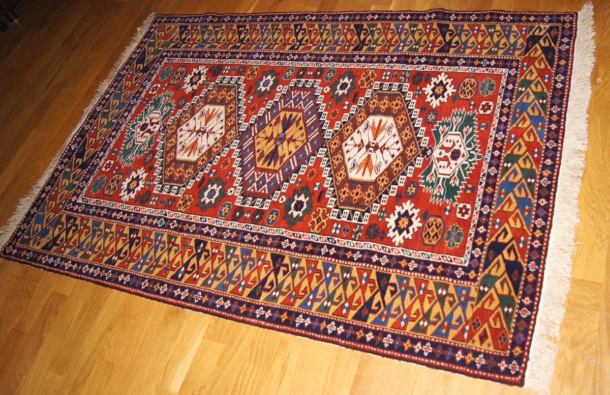 A Kuba rug with ancient Egyptian and Persian Royal