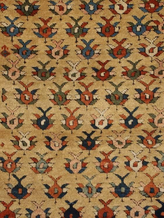 mid 19th century Kuba rug with a saffron field