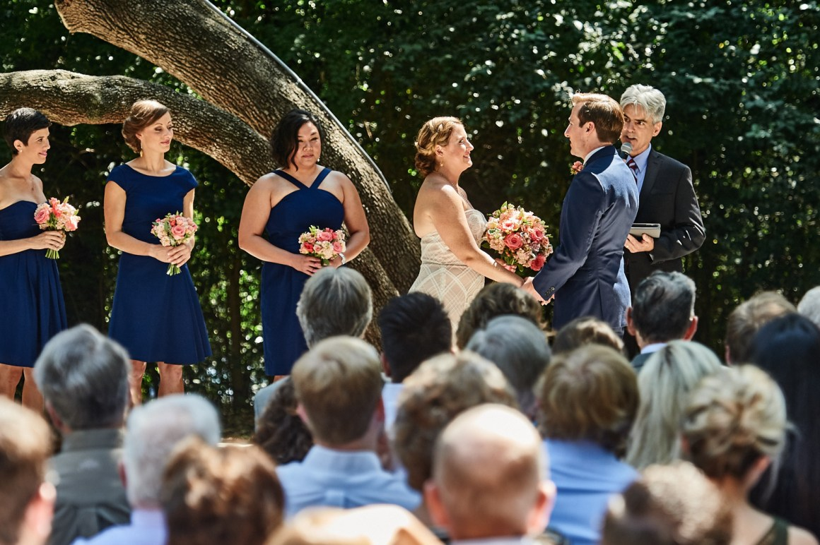 Ceremony under the oak trees at Mercury Hall.