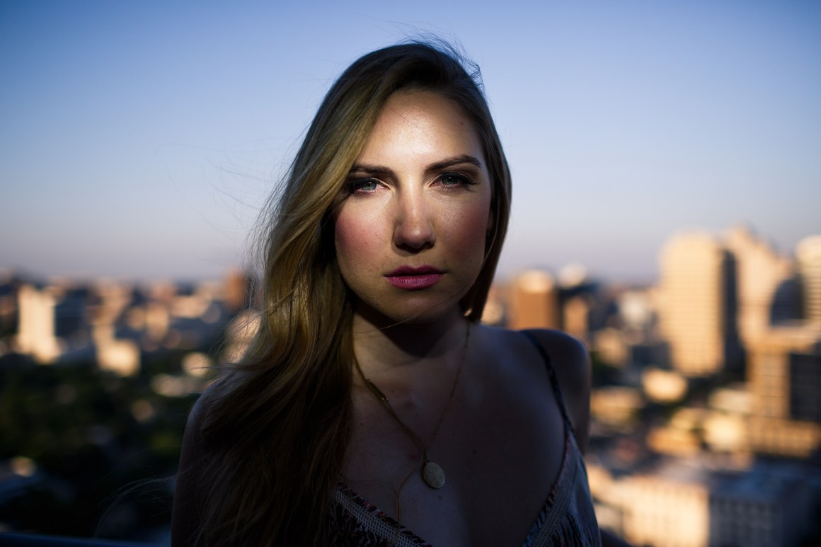 Testing out small LED's for a startup. Elizabeth against downtown with lights in close.