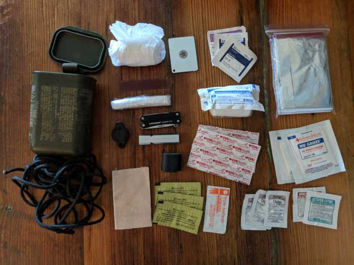 Contents of a Photographer's Emergency Survival Kit before packing into it's box.