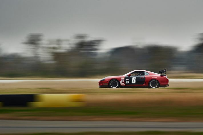 A panning shot of a race Supra showing it's speed. I chose a low shutter speed as my primary setting.