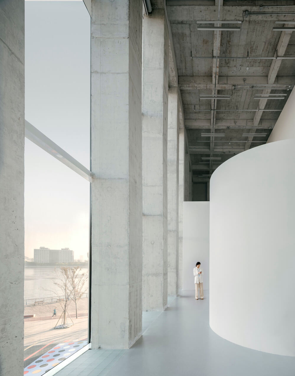 A hallway by the windows at the West Bund Museum