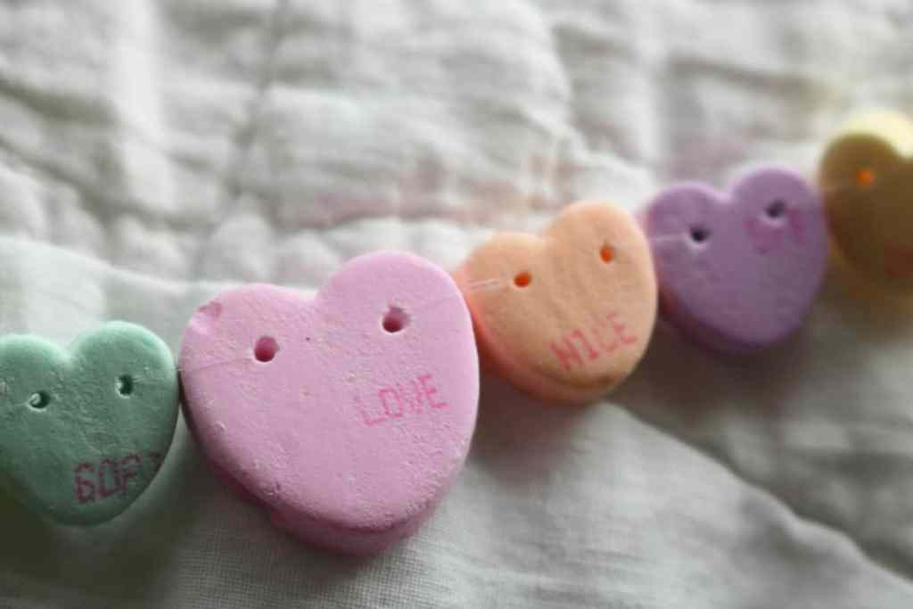 closeup of nylon string on conversation heart craft https://www.b4andafters.com/conversation-heart-necklace
