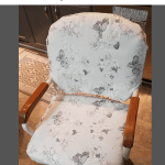 gray and white floral slipcover on a kitchen chair